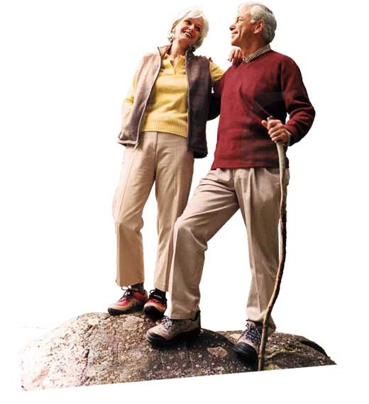 Couple standing on rock