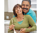 Image of Medicare-age couple cooking