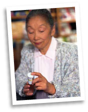 Old Woman Looking at Prescription Bottle