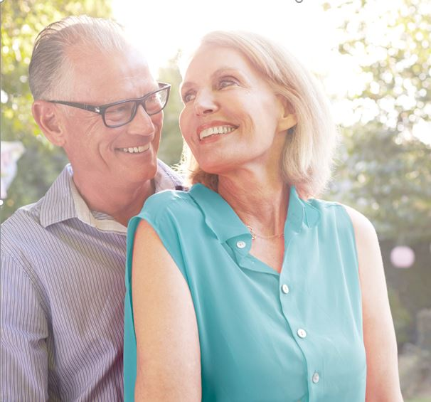 Image of senior couple outside smiling in the sun